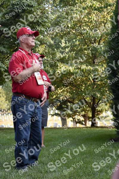 -Messenger photo by Elijah Decious<br /> <br /> John Schlafke salutes during the lowering of the flag at Arlington National Cemetary.