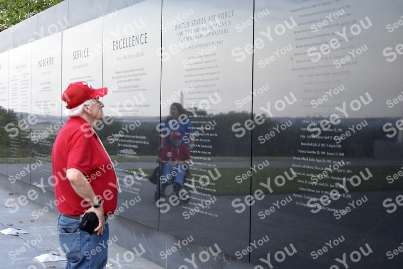 -Messenger photo by Elijah Decious<br /> <br /> Bob Kearney taked in the names on another wall at the Air Force Memorial.
