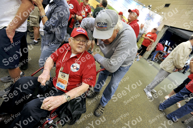-Messenger photo by Hans Madsen<br /> <br /> Navy veteran Robert Whitmer, of Spirit Lake, enjoys a little conversation Saturday morning with Brushy Creek Area Honor Flight volunteer James Ricke, of Fort Dodge as they gather for the flight to Washington D.C. Ricke is an Army veteran who served during the Vietnam era.