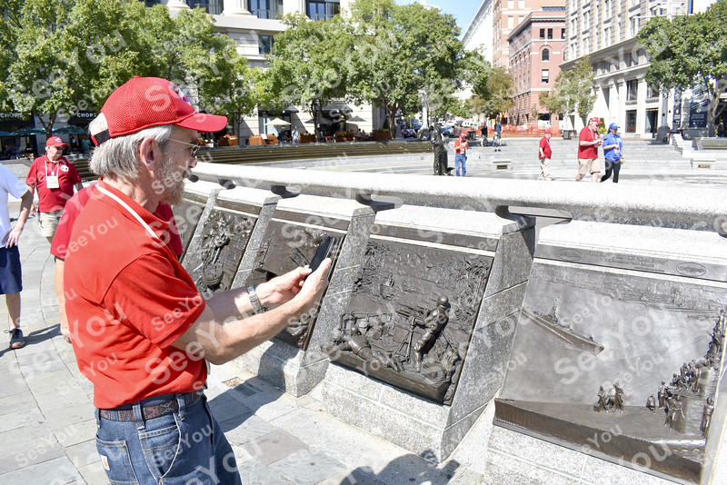 -Messenger photo by Elijah Decious<br /> <br /> Michael Wolfe, Navy veteran during the Vietnam War, admires the art on display at the U.S. Navy Memorial Plaza on Pennsylvania Avenue in Washington, D.C.