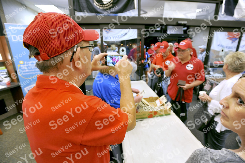-Messenger photo by Hans Madsen<br /> <br /> Army veteran Darrell Shane, of Iowa Falls, snaps a photo of his fellow Brushy Creek Area Honor Flight vets as they arrive Saturday morning at the Fort Dodge Regional Airport.