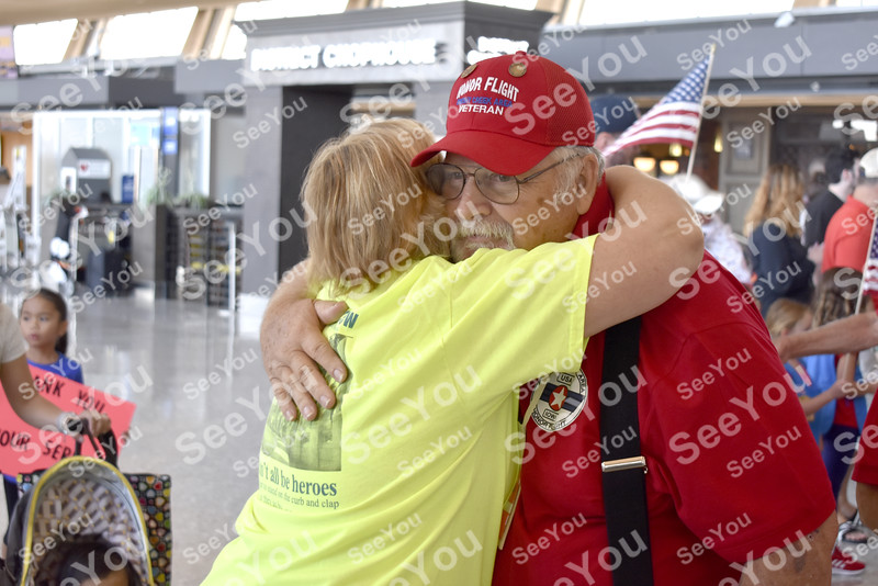 -Messenger photo by Elijah Decious<br /> <br /> Allen Free receives a hug from Marie MIller, of Centreville, Virginia, as he exits the terminal to board the bus Sunday morning.