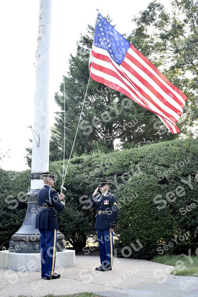 -Messenger photo by Elijah Decious<br /> <br /> Veterans witness the lowering of the flag at Arlington National Cemetary.