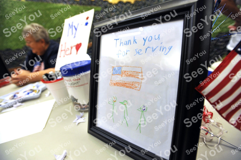 -Messenger photo by Hans Madsen<br /> <br /> Among the many cards made by local children for the vets on the Brushy Creek Area Honor Flight was this one featuring three saluting green army stick men.