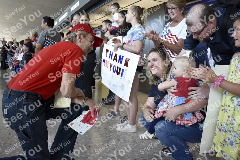 -Messenger photo by Elijah Decious<br /> <br /> Michael Wolfe of Creston is stopped in his tracks by the children in the crowd of hundreds of greeters that welcomed him at Dulles International Airport in Washington, D.C. Among them were Scarlet and her mother, Marin Ebbets, of northern Virginia.