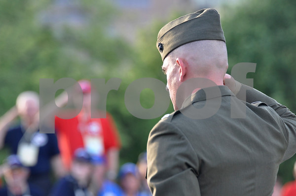 -Messenger photo by Jesse Major <br /> First Lt. Matt Rojo, public affairs office for the United States Marine Corps Training and Education Command, salutes the 99 veterans and their guardians who attended the 10th Brushy Creek Area Honor Flight to Washington, D.C., Saturday.