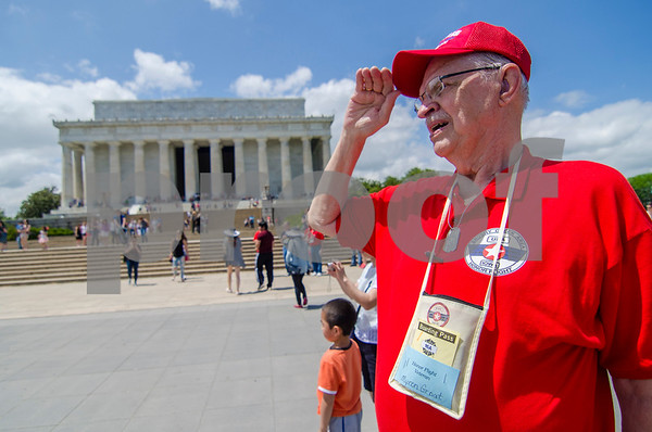 -Messenger photo by Jesse Major<br /> <br /> Army veteran Myron Groat salutes as a school band performs the Star Spangled Banner in front of the Lincoln Memorial on Saturday.