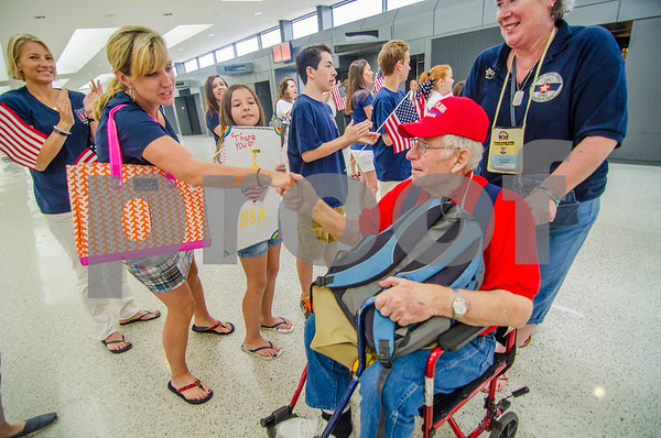 -Messenger photo by Jesse Major<br /> <br /> Korean War veteran Wilbur Eason is welcomed as a hero when he arrives to Washington Dulles International Airport by members of the Honor Flight ground crew.