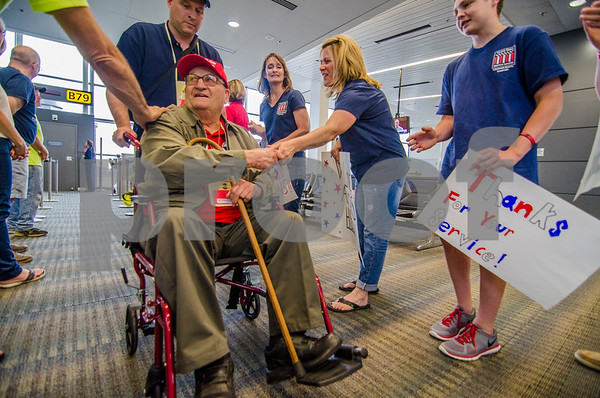 -Messenger photo by Jesse Major<br /> <br /> Dale Wetherell is greeted as a hero has he arrives to Washington Dulles International Airport on Saturday.