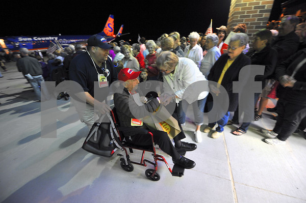 -Messenger photo by Hans Madsen<br /> <br /> Barb Schulze, of Fort Dodge, at right, welcomes World War II Navy veteran Harold Millard, of West Des Moines, and his guardian Matthew Nahnson, of Harcourt, back after their trip to Washington, D.C. on the Brushy Creek Area Honor Flight. Schulze is on the Honor Flight staff.