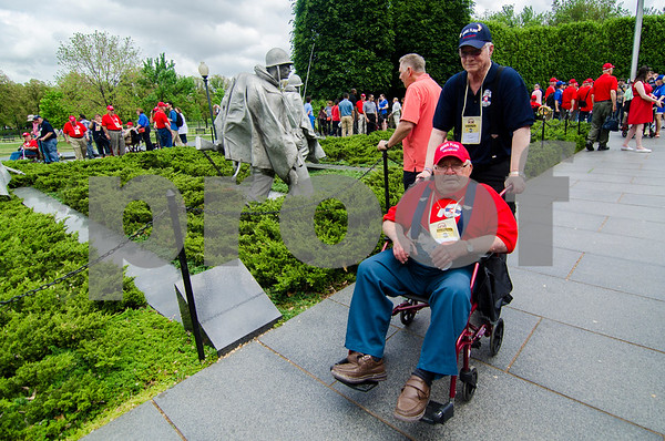 -Messenger photo by Jesse Major<br /> Guardian Robert Fort, who is a Vietnam War veteran, pushes Korean War Army veteran James Meister, of Lake View, through the Korean War Veterans Memorial in Washington, D.C., Saturday.