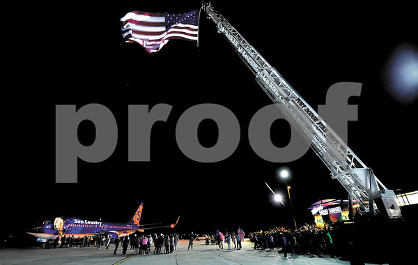 -Messenger photo by Hans Madsen<br /> <br /> The Fort Dodge Fire Department set up their ladder truck and large flag Saturday night to welcome the Brushy Creek Area Honor Flight home at the Fort Dodge Regional Airport.
