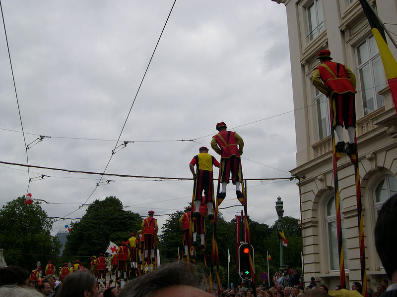A stilt walking team.  Furing pauses in the march, they would sit on the window ledges, rather than getting down from their stilts.