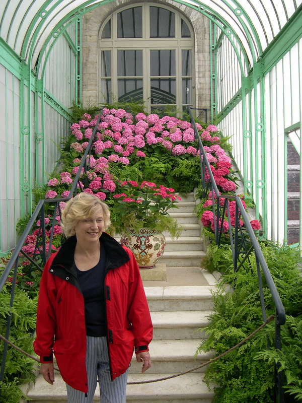 Cindy with a display of flowers behind her.