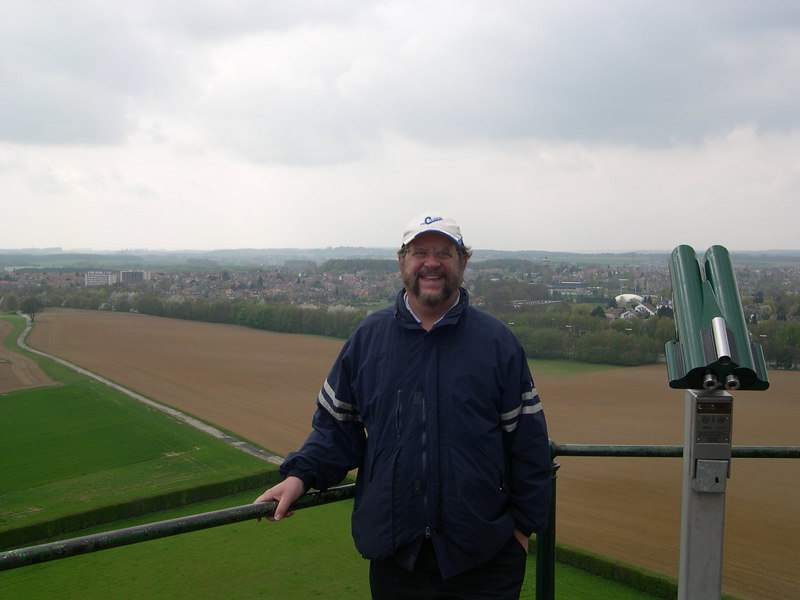 Dick on top of Lion's Mound.  In the background is the area where the English troops formed squares to fight off the attack of French cavalary during the battle.