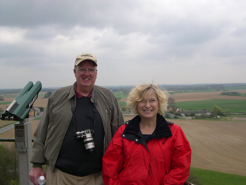 Dale and Cindy Bonga on top of Lion's Mound at the field of Waterloo, looking toward La Haye Sainte, a farmhouse which stood in the middle of the battlefield at the time of the battle of Waterloo.