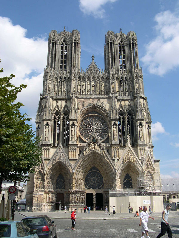 The Cathedral of Notre Dame in Reims in August.  This  Catherdral is where the coronations of French kings have been held since Clovis was baptised on this spot in AD 498.  It is perhaps best known for Jean d'Arc, who took the Dauphin there to be crowned as Charles VII, despite the fact that Reims was in enemy (i.e., English) territory.  The cathedral was extensively damaged by shelling during WW1, but it has been largely reconstructed and is a beautiful place.