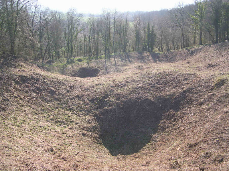 The Butte de Vauquois in spring, showing the line of mine craters that split the hill into two parts, with the German and French lines on either side.