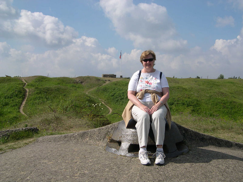 Susan on top of Fort Vaux, sitting on one of the gun turrets.  The top of the fort shows the effects of the continuous shelling it received.