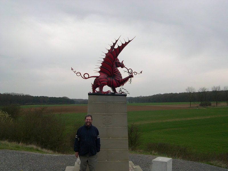 Dick in front of the Welsh memorial, with Mametz Woods in the background.