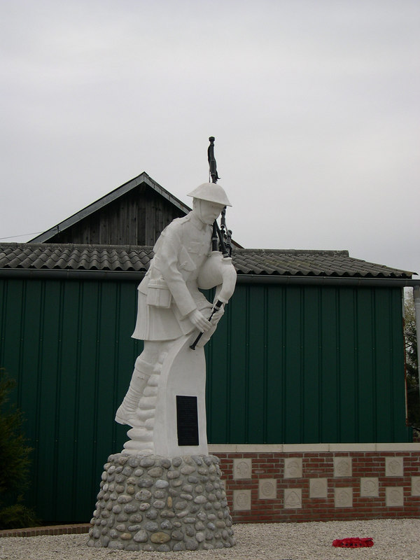 Statue of a Scottish bagpiper in the village of Longueval at the Somme.
