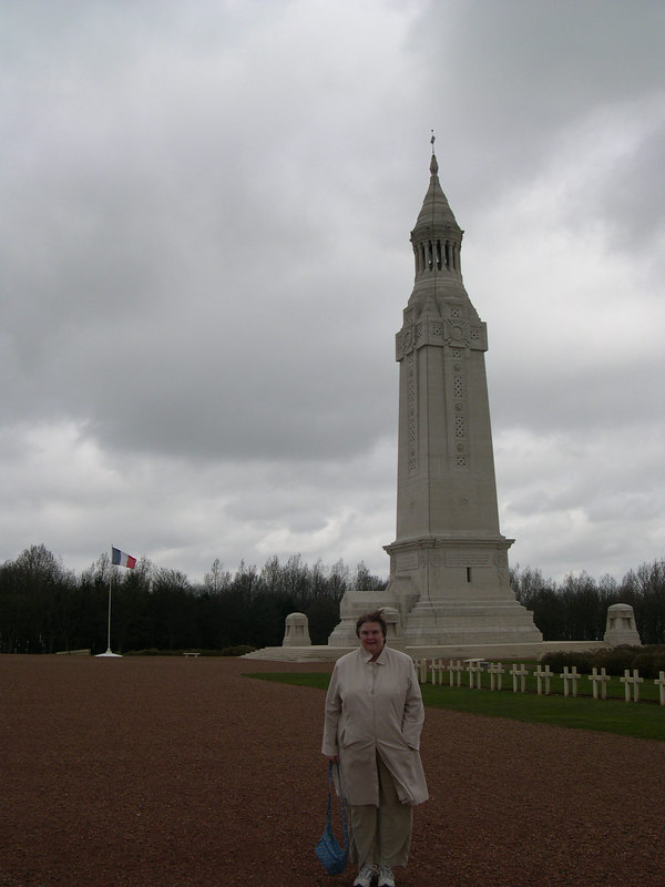 Susan in front of the memorial tower at the French National Memorial and Cemetary at Notre Dame de Lorette, north of the city of Arras and close to Vimy Ridge.  This commemorates the French battles in this area in 1915, after the trench lines had formed in WW1.  Along with Douamont at Verdun, it is one of the two major French memorials to the war.