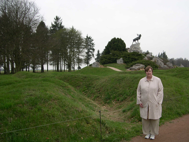 Susan at the Beaumont Hamel Canadian Memorial.  She is standing by one of the original trenches, with a Caribou, emblem of Newfoundland, in the background.  In the attack on July 1, 801 Newfoundland soldiers went on the attack at this location.  After 25 minutes, only 68 soldiers remained alive and unwounded, one of the highest casulty rates for any regiment on July 1.