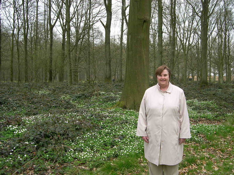 Susan in Delville Woods with spring wildflowers behind her.
