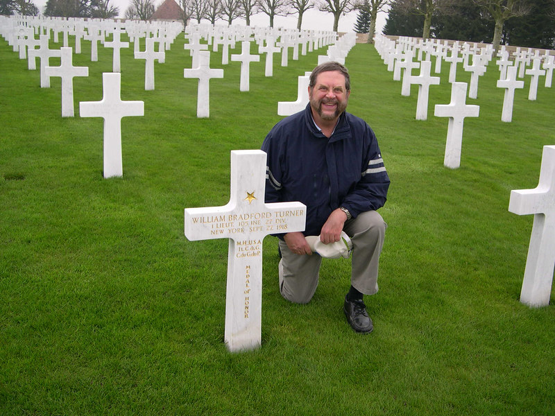 Dick at the American Cemetary at Bony on the Hindenburg Line.  He is kneeling next to the grave of Lt. William B. Turner, a Medal of Honor winner for his actions on September 29 1918.