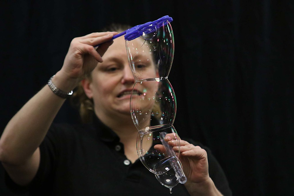 ". Megan Parker with ""Party Bubbles\"" brought her show to the Leominster Public Library on Thursday afternoon for a packed house of kids and parents. Here she shows that bubbles can have a flat side when put together. SENTINEL & ENTERPRISE/JOHN LOVE"