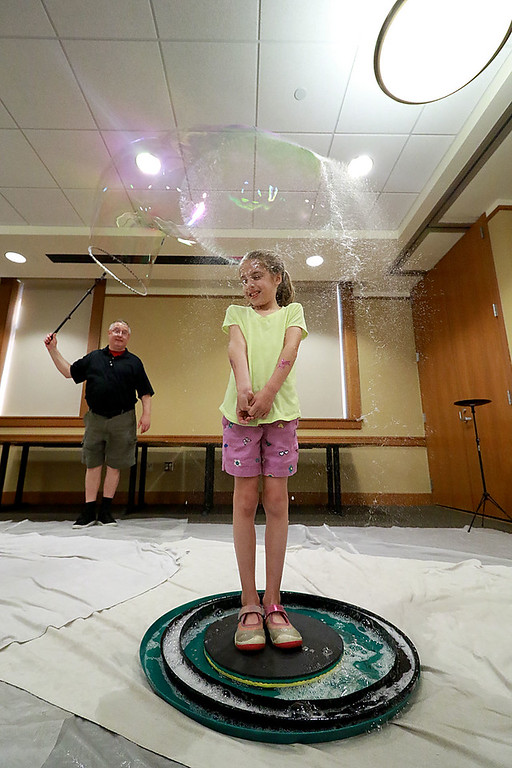 . Keith Johnson from Rhode Island was at the Leominster Public Library on Tuesday with his show and knowledge of bubbles. At the end of Johnson\'s show he put one lucky audience member in a bubble. That lucky person was Cailyn Kindorf, 7, from Sterling. Here you can see the bubble popping around her. SENTINEL & ENTERPRISE/JOHN LOVE