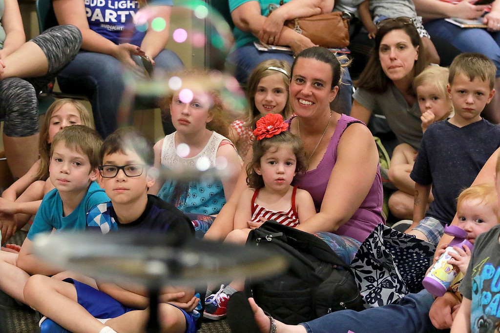 . Keith Johnson from Rhode Island was at the Leominster Public Library on Tuesday with his show and knowledge of bubbles. Kids and parents watch a Johnson makes bubbles during his show.  SENTINEL & ENTERPRISE/JOHN LOVE