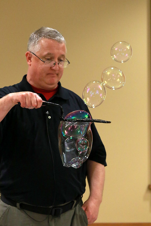 . Keith Johnson from Rhode Island was at the Leominster Public Library on Tuesday with his show and knowledge of bubbles. After Johnson put some bubbles inside a bubble he show how he could release them. SENTINEL & ENTERPRISE/JOHN LOVE