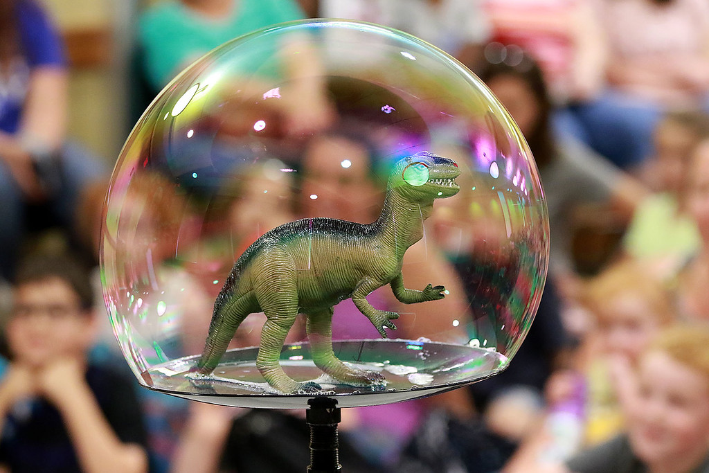 . Keith Johnson from Rhode Island was at the Leominster Public Library on Tuesday with his show and knowledge of bubbles. During his show Johnson put a dinosaur inside a bubble. SENTINEL & ENTERPRISE/JOHN LOVE