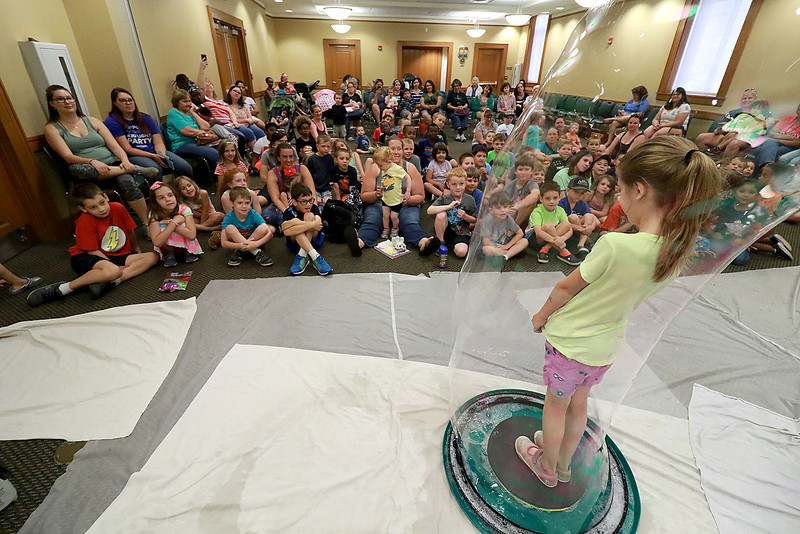 Keith Johnson from Rhode Island was at the Leominster Public Library on Tuesday with his show and knowledge of bubbles. At the end of Johnson's show he put one lucky audience member in a bubble. That lucky person was Cailyn Kindorf, 7, from Sterling. SENTINEL & ENTERPRISE/JOHN LOVE