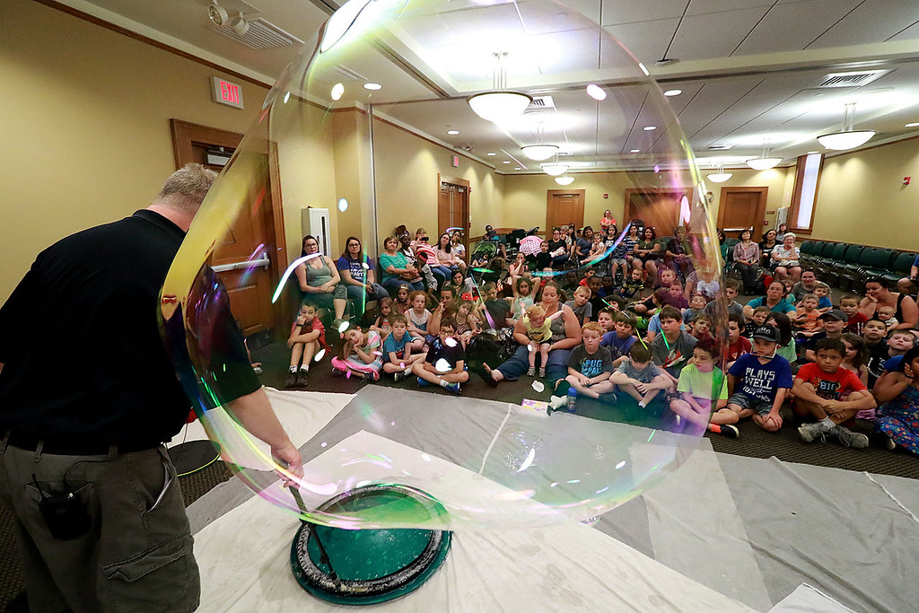 . Keith Johnson from Rhode Island was at the Leominster Public Library on Tuesday with his show and knowledge of bubbles. Kids and parents watched as Johnson made bubbles fly all around the room during his show. SENTINEL & ENTERPRISE/JOHN LOVE