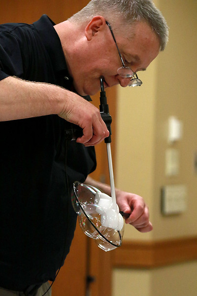 Keith Johnson from Rhode Island was at the Leominster Public Library on Tuesday with his show and knowledge of bubbles. Johnson shows off one of his tricks during his show. After putting six bubbles together he blew some smoke into a few of them to make a star. SENTINEL & ENTERPRISE/JOHN LOVE