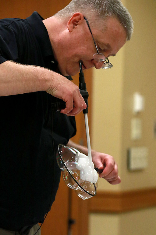 . Keith Johnson from Rhode Island was at the Leominster Public Library on Tuesday with his show and knowledge of bubbles. Johnson shows off one of his tricks during his show. After putting six bubbles together he blew some smoke into a few of them to make a star. SENTINEL & ENTERPRISE/JOHN LOVE