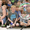 Keith Johnson from Rhode Island was at the Leominster Public Library on Tuesday with his show and knowledge of bubbles. Kids and parents watch his bubbles fly all around the room during his show.  SENTINEL & ENTERPRISE/JOHN LOVE