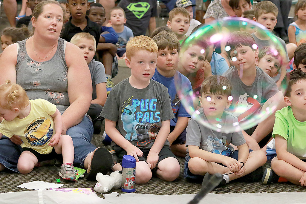 . Keith Johnson from Rhode Island was at the Leominster Public Library on Tuesday with his show and knowledge of bubbles. Kids and parents watch his bubbles fly all around the room during his show.  SENTINEL & ENTERPRISE/JOHN LOVE