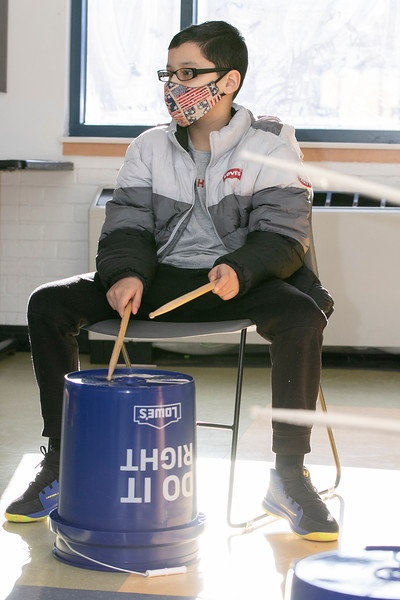 One of the classes at the Boys and Girls Club of Fitchburg and Leominster is Bucket Drumming taught by Tim Kane from Worcester. Fabrizio Davila, 10, follows Kane as he learns to play some beats on the bucket.  SENTINEL & ENTERPRISE/JOHN LOVE