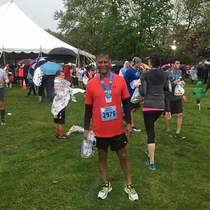 Chand Siewrattan, of Warminster, wearing his 2016 Broad Street Run medal proudly at the Philadelphia Navy Yard after completing the 10-mile race in 1 hour and 19 minutes May 1, 2016, Philadelphia, PA.
