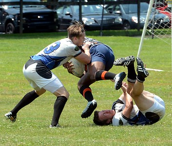 Steve Spadaccino (#13), left, and Kyle Standoft (11) upend Black Fox runner in recent rugby battle for the Bucks County Sharks. From Langhorne, Spadaccino is getting interest from the US National team. (Photos by John Gleeson – 21st-Century Media)
