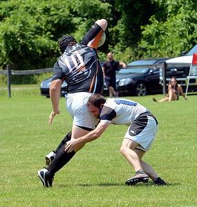 Ryan Sodano (#15) brings down hefty Black Fox ballcarrier.