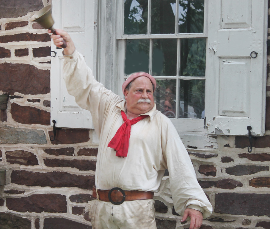 . Town Crier Robert Scordia of Fairless Hills rings a bell to alert visitors to the reading of the Declaration of Independence.