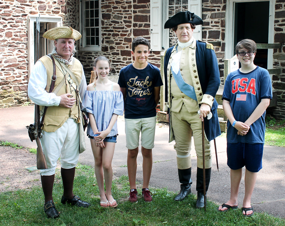 . Enjoying the Fourth at Washington Crossing Historic Park are Madison and David Jr. Pipitone, their guest from the Bordeaux region of France, Xavier Maison, Gen. Washington and another re-enactor.