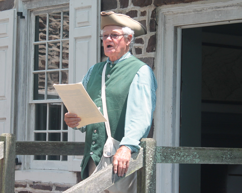 . Thomas Maddock reads the Declaration of Independence on the steps of the McConkey Ferry Inn.
