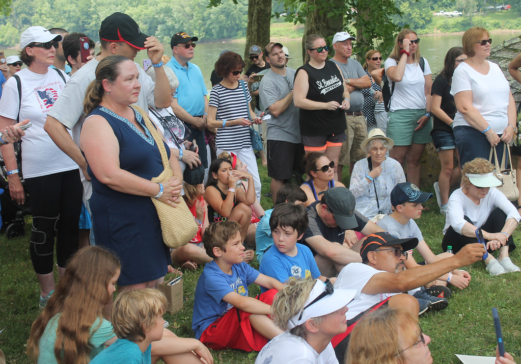 . A crowd listens as the Declaration of Independence is read aloud.