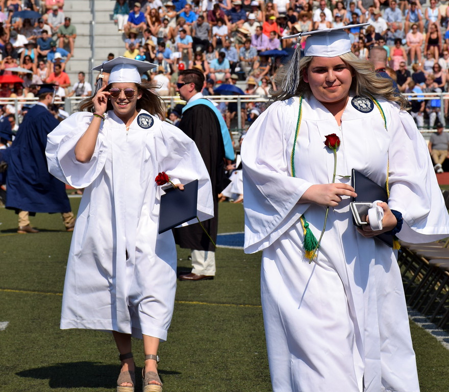 . Shannon Perry followed Katie Perera walk off with smiles after receiving their diplomas on Tuesday, June 13, 2017. Debby High for Digital First Media