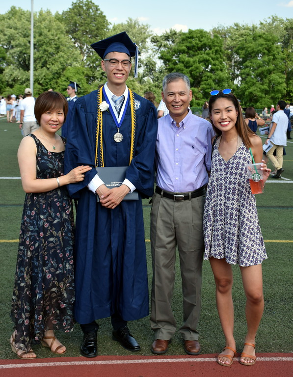 . Calvin Dominic Yu surrounded by his family after Council Rock High School North Graduation Cememony ended. (Debby High for Digital First Media)